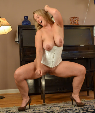 Curvy Blonde Nixie at the Piano